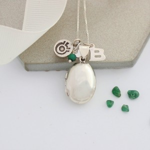 silver oval locket with emerald for may (1)