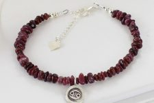 Ruby gemstone bracelet with cancer star sign charm