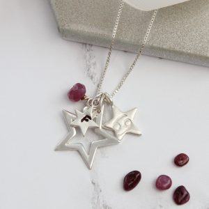 Silver Star necklace personalsied with ruby and Cancer zodaic charm for July