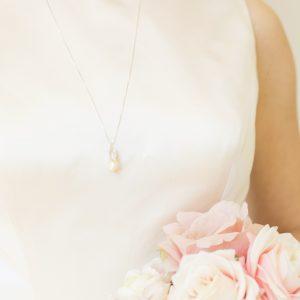 Modern white natural fireball pearl pendant for a bride