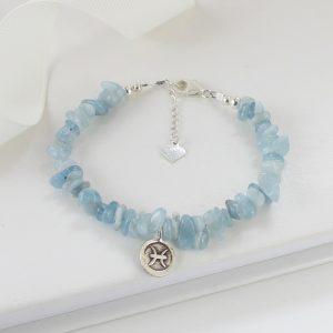 Aquamarine gemstone bracelet with a Pisces zodiac charm
